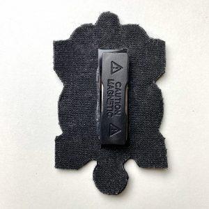 Escudo con imán para chaqueta